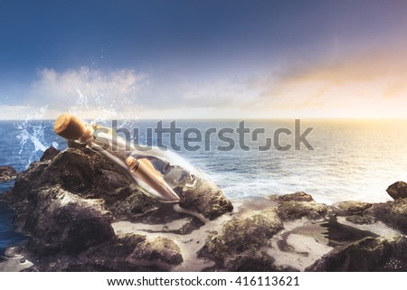 message in a bottle at sea - stock photo
