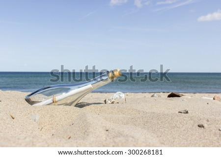 Message in a Bottle on the sandy beach / Message in a Bottle / beach