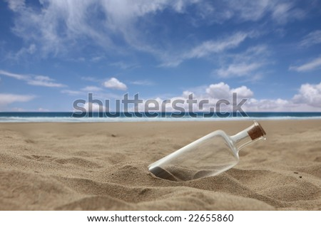 Message in a Bottle Washed Ashore a Beach With Cork. Message is Missing. - stock photo