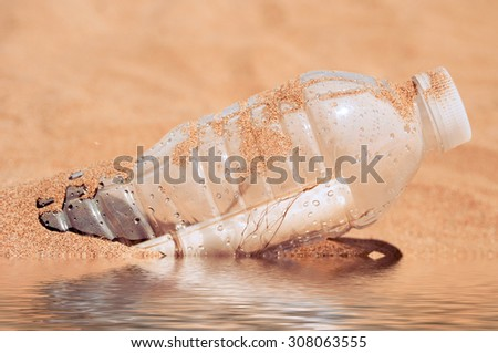 Message in bottle on the sand beach