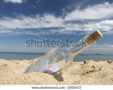 Message in the bottle washed ashore - stock photo