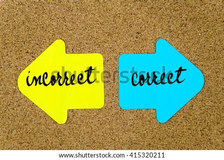 Message Incorrect versus Correct on yellow and blue paper notes as opposite arrows pinned on cork board with thumbtacks. Choice conceptual image - stock photo