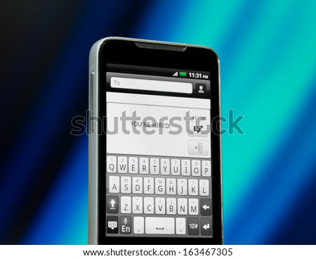 Message on a smartphone's display - stock photo