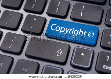message on keyboard enter key, to illustrate the concepts of copyright. - stock photo