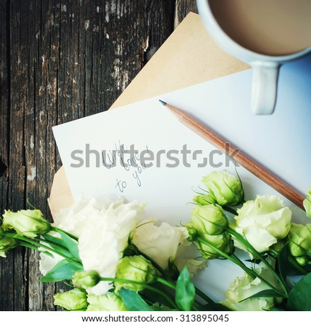 Message on Letter with Love You, Cup, Pencil, Light Green Roses to Valentine's Day on Wooden Table. Vintage Style - stock photo