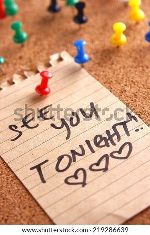 "Message or reminder board with ""see you tonight"" note Photo of a cork, message or reminder board with a note saying ""see you tonight"" - stock photo"