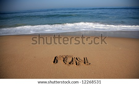 """Message says """"'fun""""  in the Sand on a Beach with waves and blue ocean concepts - stock photo"""