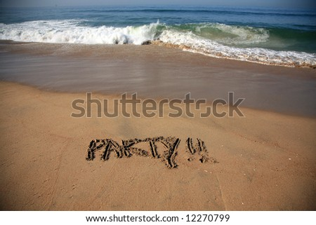 """Message says """"party""""   in the Sand on a Beach with waves and blue ocean concepts - stock photo"""