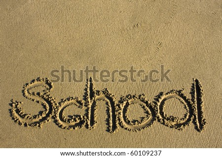 """Message says """"school"""" in the Sand on a Beach and texture area upper - stock photo"""