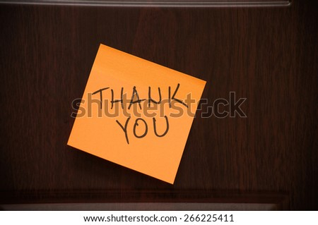 "Message ""Thank You"" handwritten on the sticky note on the wooden door - stock photo"