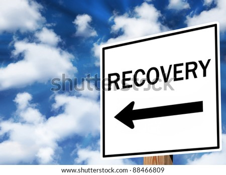Message traffic sign about economic recovery and health. - stock photo