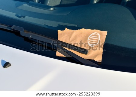Message under a windshield wiper with easter egg and copy space