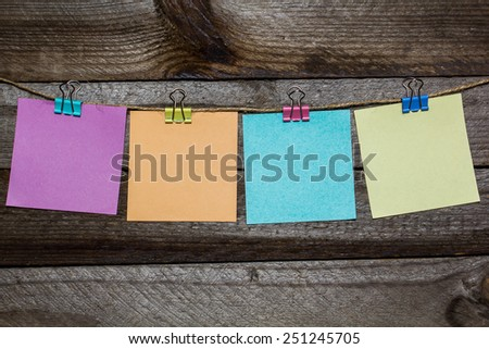 Message written on a paper hanging on the clothesline on wooden background with hearts