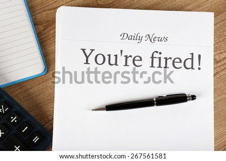 Message You're Fired on wooden table, top view - stock photo