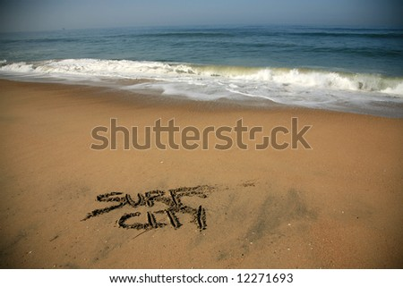 """Messages says """"surf city""""  in the Sand on a Beach with waves and blue ocean concepts - stock photo"""