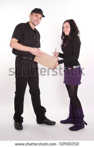 Messenger delivering a parcel to an attractive brunette - stock photo