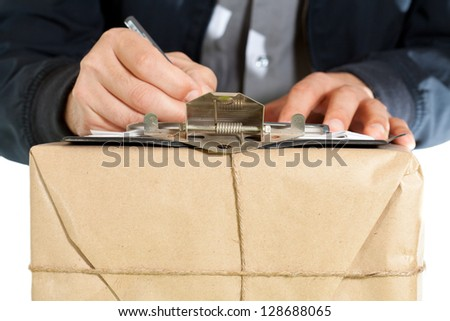Messenger with your notebook to deliver a package - stock photo