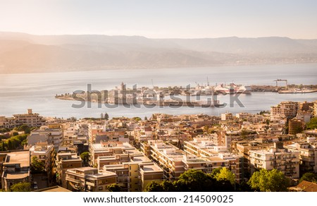Messina city, harbour and channel view in warm light just before sunset - stock photo