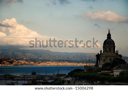 Messina strait at sunset with clouds, port ad church - stock photo