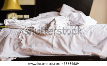 Messy bed after wake up in the morning. - stock photo