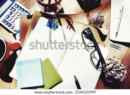 Messy Designer's Table Blank Note Tools Concept - stock photo