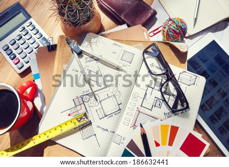 Messy Designer's Table with Sketch and Tools - stock photo