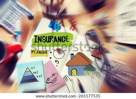 Messy Desk with Insurance Related Notes - stock photo