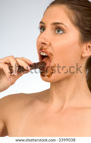 Messy dirty chocolate eating - stock photo