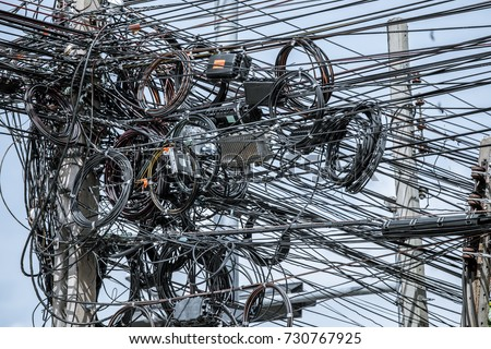 messy electrical cables on post