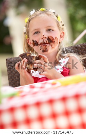 Messy Girl Eating Chocolate Cake - stock photo