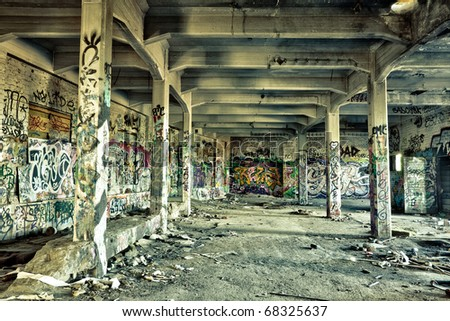 messy old warehouse - stock photo