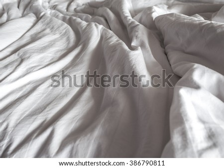Messy white bed and two pillow, in the morning - stock photo