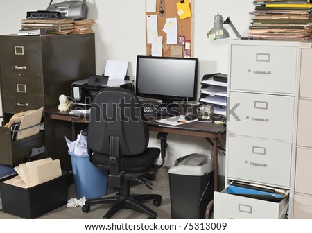 Messy work space with piles of files. - stock photo