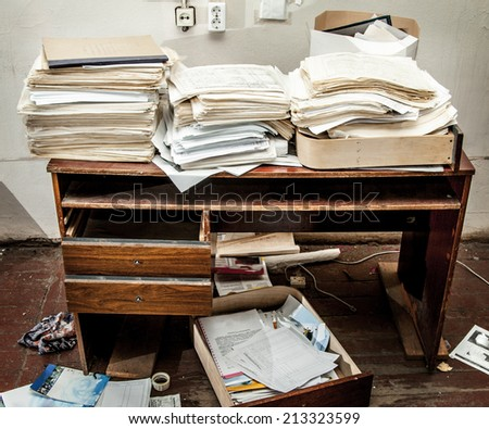 Messy workplace with stack of paper - stock photo