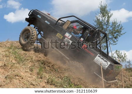 "MESTECKO TRNAVKA,  CZECH REPUBLIC - AUG 29: Black off road car is on the top of the steep hill at ""Big Shock Cup 2015"" on August 29, 2015  in Mestecko Trnavka, Czech Republic."