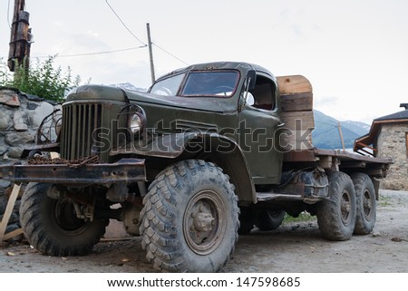 MESTIA, GEORGIA - JUNE 27: Old russian truck parked on June 27, 2013 in Mestia, Georgia. In post-comunist lands, old russian trucks are still in service.
