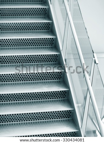 Metal abstract empty steps in modern airport - stock photo