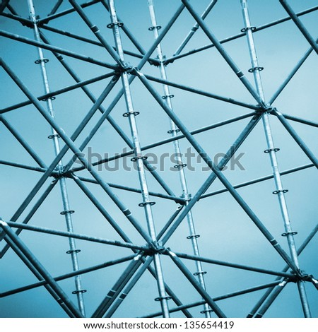 metal abstract structure ; scaffolding on construction site - stock photo