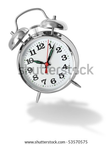 Metal alarm clock bouncing and ringing on white background - stock photo