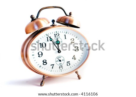 metal alarm clock on the white background