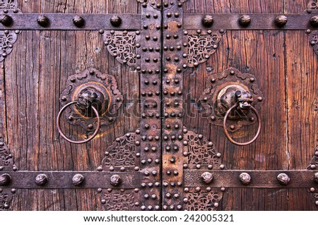 Metal and wooden ancient chinese doors with knockers