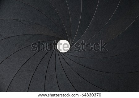 metal aperture with small hole as background