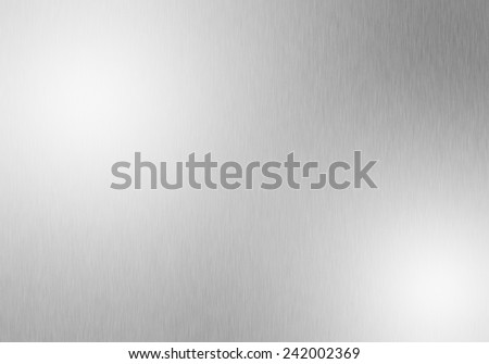 Metal background of brushed steel plate with reflections, steel - stock photo