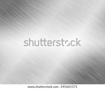 Metal background or texture of brushed steel plate with reflections and shiny  - stock photo