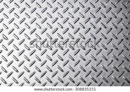 Metal background texture. Diamond plate. - stock photo
