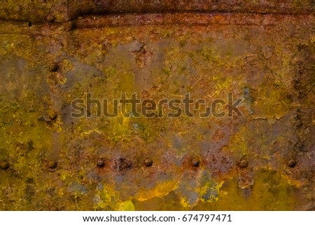 Metal background with corrosion and oxidation and traces of peeling paint
