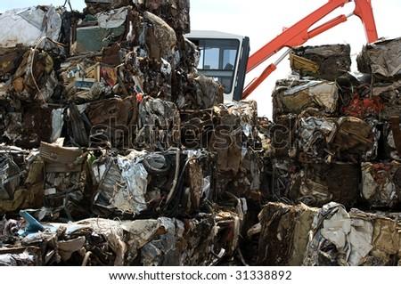 Metal bales in a junkyard - stock photo