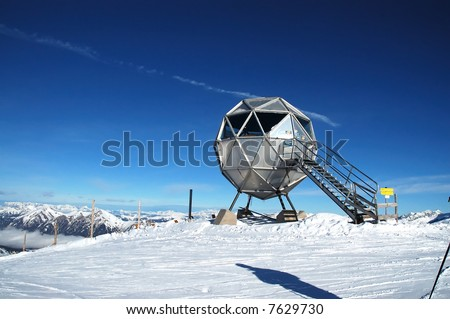 Metal ball-shaped weather station on mountain top iwith higly polarized sky - stock photo