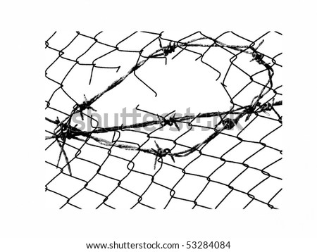 Metal barbed wire fence - stock photo