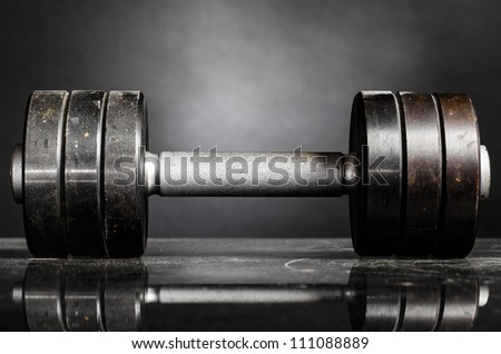 metal barbell on dark gray background - stock photo